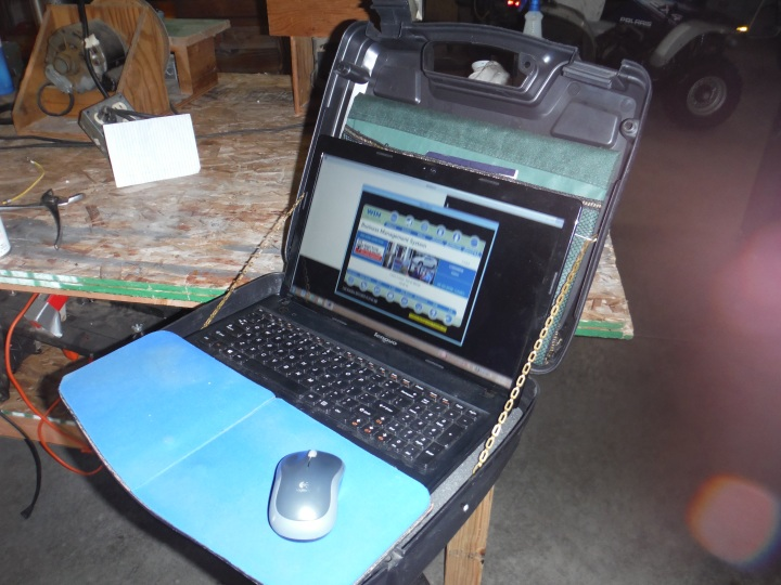 Showing stand with computer and mouse pad platform.