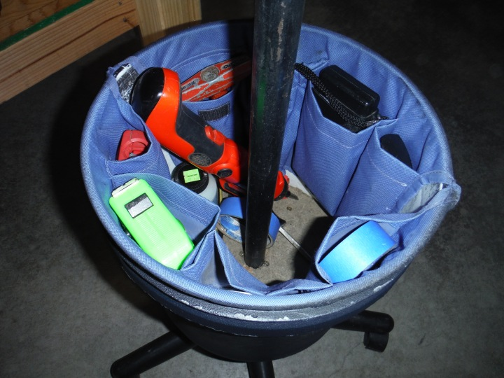 Tool apron on inside the bucket.